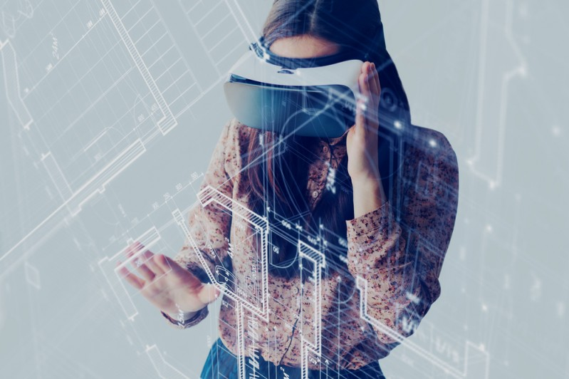 Woman using VR learning to view plans